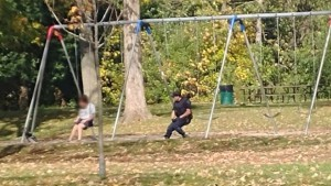 Canadian Police Officer Joins Man On Swing Set During Distress Episode